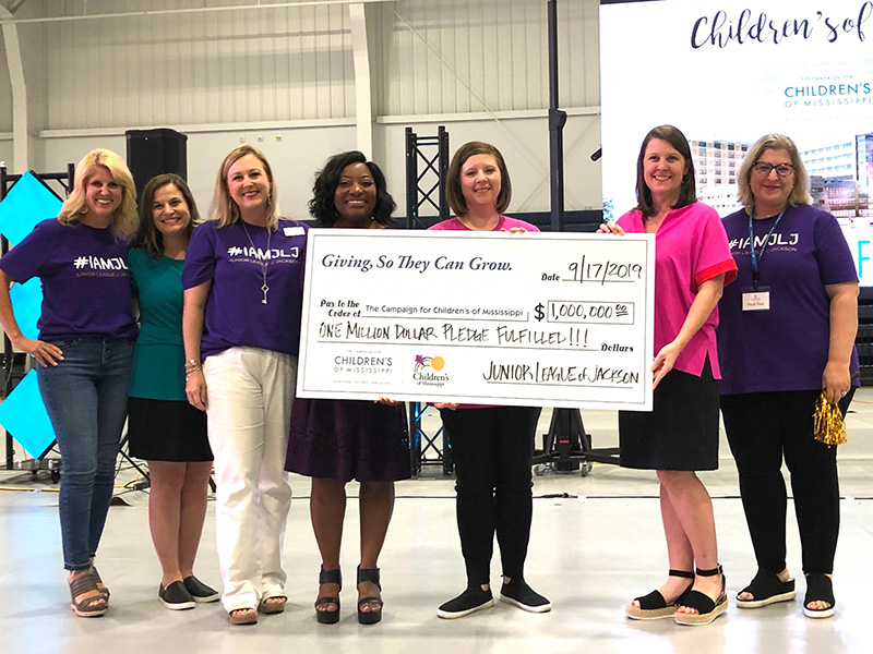 Celebrating the Junior League of Jackson's $1 million gift to the Campaign for Children's of Mississippi are, from left, Meredith Aldridge, 2018-2019 JLJ president and director of development for Children's of Mississippi; Keri Henley, UMMC associate executive director of development; Melanie Hataway, 2016-2017 JLJ president; 2019-2020 JLJ president LaKeysha Greer Isaac; Dr. Barbara Saunders, JLJ member and division chief for Child Development at UMMC's Center for Advancement of Youth; Natalie Hutto, executive director of the Department of Pediatrics at UMMC; and Heidi Noel, 2017-2018 JLJ president.