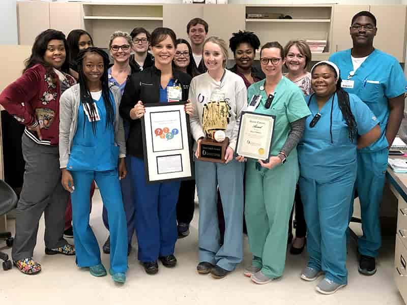Kelli Ferrell, an admission and discharge nurse on 4Wiser, received a Good Catch Award from the Patient Quality and Safety Group for discovering an overlooked order regarding changing a patient's wound VAC