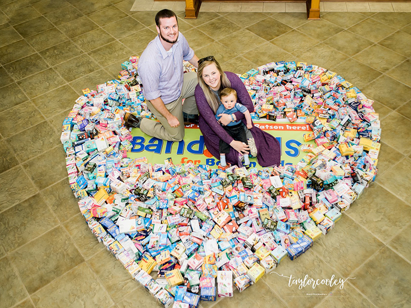 Mark and Paige Welch and son Jack show some of the many Band-Aids collected through their Band-Aids for Batson campaign. (Photo courtesy of Taylor Cooley Photography)