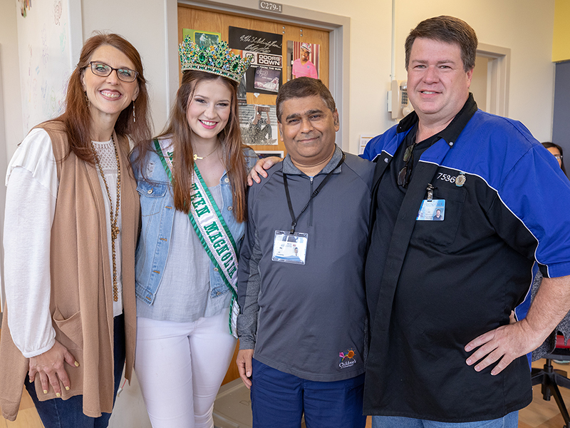 Dr. Ashley Bhatt, third from left, UMMC neonatologist, reunites with Savannah Richardson 18 years after the former patient left Batson Children's Hospital. With them are Richardson's parents, Jennifer and Bill.