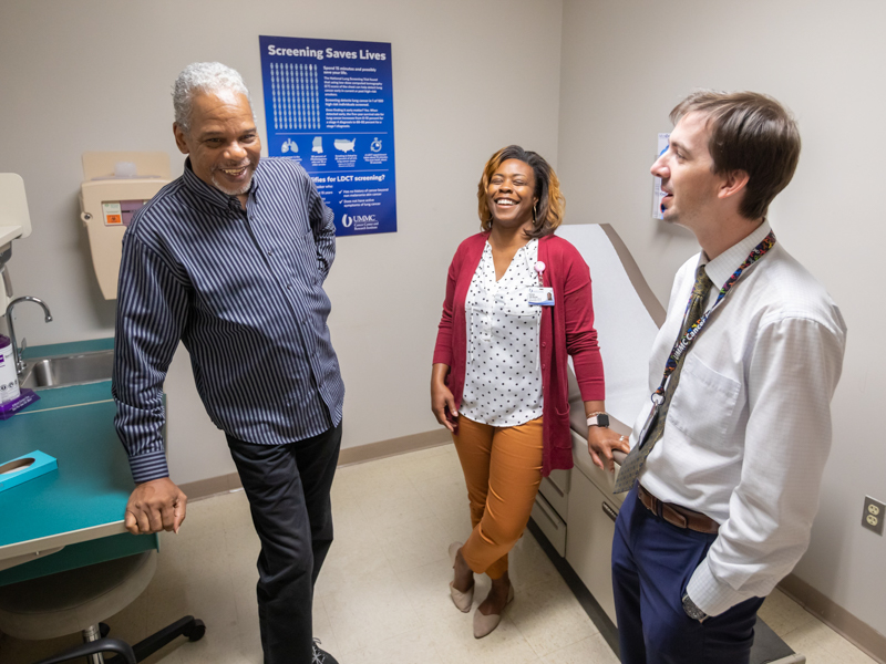 Ronald Givens of Byram, left, talks to Anastasia Smith-McEwen, his smoking cessation counselor, and Jonathan Hontzas, lung cancer screening program co-director.