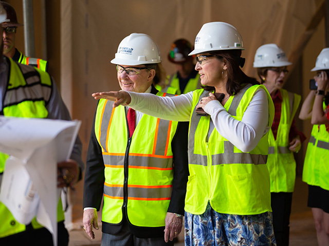 Dr. Mary Taylor, chair of pediatrics, shows Sanderson Farms CEO and board chairman Joe Sanderson some of the features of the new children's hospital tower. Sanderson and his wife, Kathy, chair the Campaign for Children's of Mississippi.