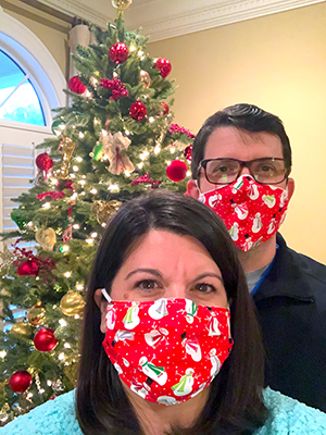 DeAnna and Dr. Benjamin Dillard display holiday-themed masks.