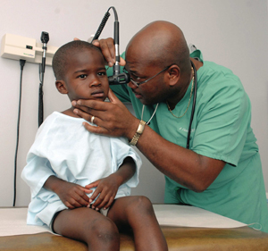 Dr. Audwin Fletcher examines 3-year-old Edward Smith of Jackson.