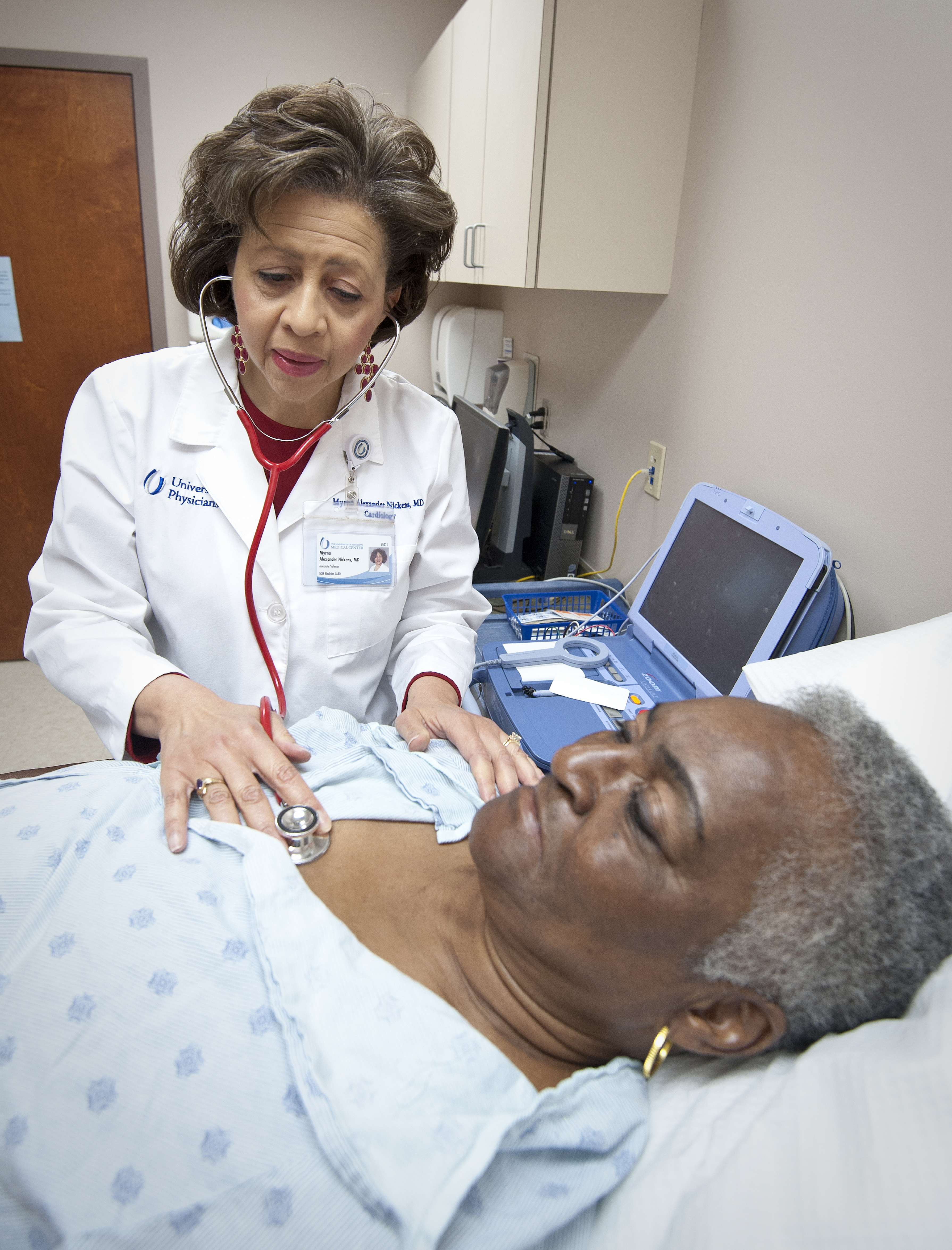 Dr. Myrna Alexander listens to the heart of Elizabeth Greer of Lexington