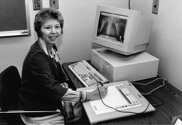 Ada Seltzer demonstrates an early computer program that displays an X-ray on the screen.