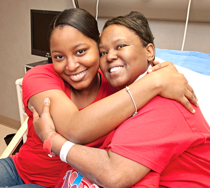 Sharon, right, gets a big hug from her daughter Ronneccia Mackey.