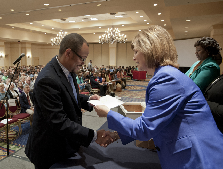 Dr. LouAnn Woodward, right, associate vice chancellor for health affairs and vice dean of the School of Medicine, gives Willie Thompson, Jr. his match envelope. He matched with East Tennessee State University in psychiatry.