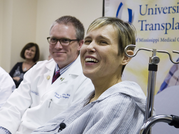 Battle is jubilant during a press conference after her liver transplant in March 2013. Pictured with her is Dr. Chris Anderson.