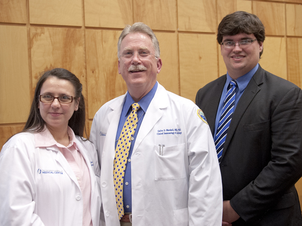 The Department of Medicine and Medical Student Research Program teamed up on March 31 to hold a joint Research Day. Pictured are Dr. Licy Yanes Cardozo, left, who won first place in the poster competition for DOM; Dr. Gailen Marshall, center, UMMC professor of medicine and pediatrics and DOM Vice Chair for Research; and Reed Gilbow, a third year medical student who won first place in the MSRP poster competition.