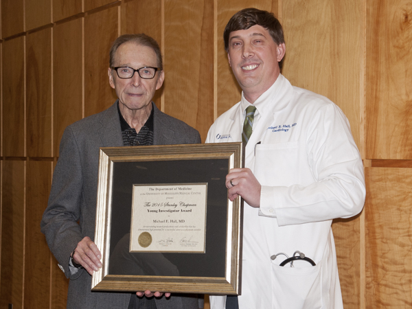 Dr. Stanley Chapman, left, professor emeritus of  infectious diseases at UMMC, poses with Dr. Michael Hall, the first recipient of the Stanley Chapman Young Investigator Award during the 2015 Department of Medicine Research Day event.