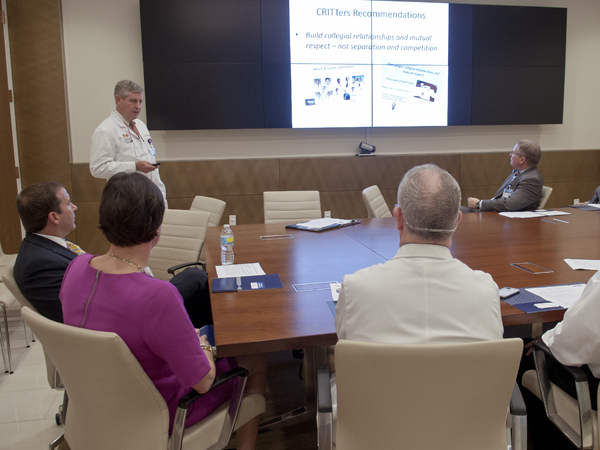 Purvis, back left, explains what can be done to improve relations with private-practice physicians and how the initiative fits in with the UMMC/2020 Strategic Plan.