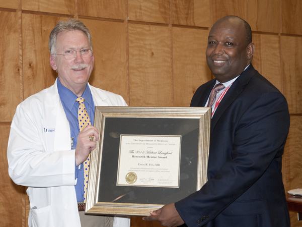 Dr. Gailen Marshall, UMMC professor of medicine and pediatrics and Vice Chair for Research in the Department of Medicine, left, poses with Dr. Ervin Fox, the 2015 Herbert Langford Research Mentor Award, professor of medicine, at the annual DOM Research Day event on March 31.