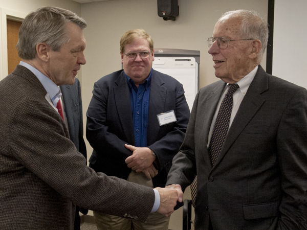 "Dr. Doug Rouse, left, greets former Gov. William Winter, who served as attorney for the ""Recalcitrant Residents"" in 1976. Looking on, center, is Dr. David Gandy."