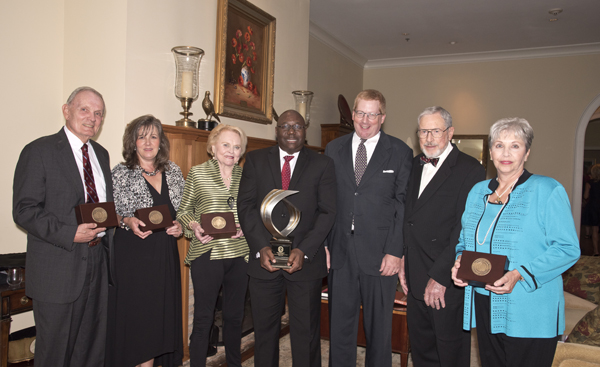 Medical Alumni & Friends Awards Dinner honorees or their family members are, from left: Dr. James Hughes; Dr. Barbara Goodman, who accepted the honor on behalf of Dr. Charles Castle; Jan Evers, who acknowledged the honor on behalf of her late husband, Dr. Carl Evers; Dr. Claude Brunson, recipient of the Distinguished Medical Alumnus Award; awards presenter Dr. Erik Richardson, president of the Medical Alumni Chapter; Dr. John Jackson; and Kathryn Boronow, who received the award on behalf of her late husband, Dr. Richard Boronow.