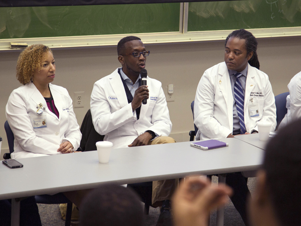 Among the panelists are, from left, Dr. Shawn McKinney, associate professor of surgery, Dr. Gerald McKinney (with microphone), associate professor of surgery, and Dr. Michael Holder, associate professor of pediatrics and executive director of simulation and interprofessional education.