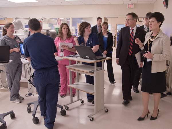 Savich (far right) and Vitter (second from right), chat with residents and fellows at the University of Mississippi Medical Center's NICU.