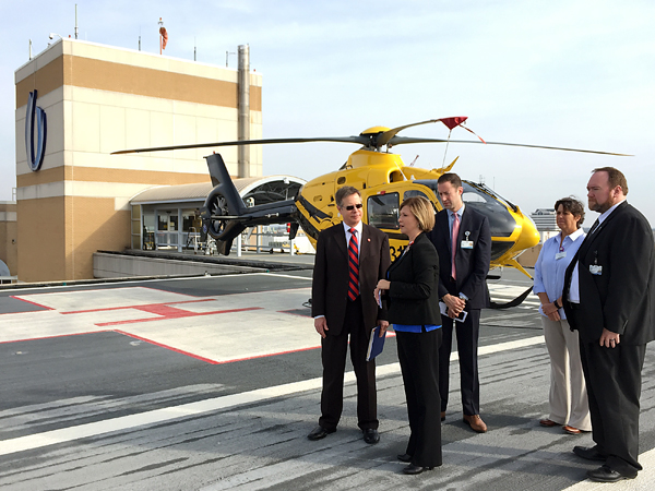 Woodward (second from left), gives Vitter (left), a tour of the Medical Center's AirCare helipad. Assisting are Dr. Brian Rutledge (center), Woodward's chief of staff; Donna Norris, MED-COM clinical director; and chief administrative officer Jonathan Wilson.