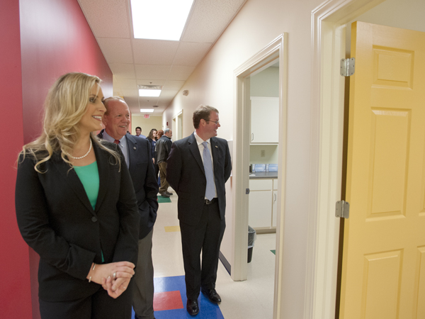 Julie Sparks, nurse coordinator at Children's of Mississippi's new Tupelo clinic, gives a tour of the facility to Chauncey Godwin (center), chair of the Tupelo Community Development Foundation; and Tupelo Mayor Jason Shelton.