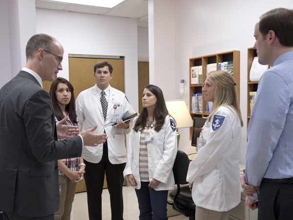 Rodgers, far left, and Tull, far right, discuss treatment of bipolar disorder with, from left, Dr. Sadia Haque, a fourth year psychiatry resident; and third-year medical students Jeremy Archer, Tara Lewis and Julie Waddle.