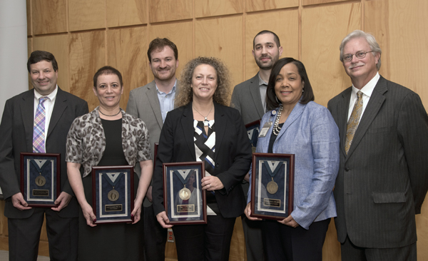 Standing with Summers, right, are 2015 Bronze Award recipients from left, Romero, Levenson, Vallender, Coolen, Harmancey and Beech.