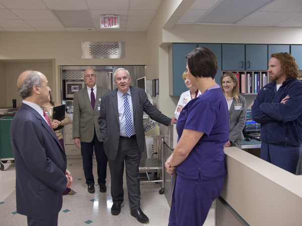 (From left) Dr. Mark Chassin, CEO and president of The Joint Commission; Dr. Thomas Prewitt; and Dr. Michael Henderson chat with SICU nurses.