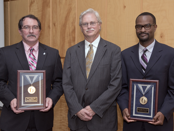 Standing with Summers, center, are 2015 Gold Award recipients Duhe, left, and Sims.