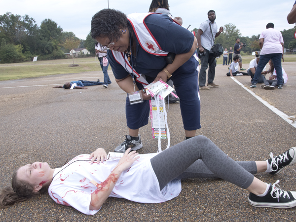 "Ollie Harper, a Jackson State University nurse practitioner, assesses the ""injuries"" of Northwest Rankin Middle School student Whitney Robinson"