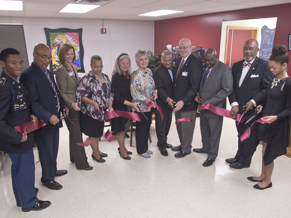 Taking part in the ribbon-cutting for the Lanier High School Teen Wellness Clinic were (from left) Lanier student Jaylin Rodgers, an ROTC cadet lieutenant colonel; Principal Eric Johnson; University of Mississippi School of Nursing Dean Dr. Kim Hoover; Lanier alumnus Hazel Shields; Dr. Janet Harris, School of Nursing associate dean and director of practice and community engagement; Dr. Kate Fouquier, a certified nurse midwife and associate professor in the School of Nursing; Jackson Public Schools Superintendent Dr. Cedrick Gray; Dr. James Keeton, former UMMC vice chancellor for health affairs and now distinguished professor and advisor to the vice chancellor; Dr. Claude Brunson, UMMC senior advisor to the vice chancellor for external affairs; Jackson businessman and Lanier alumnus Al Thomas; and Lanier senior Lauren Porter, granddaughter of the late Dr. Aaron Shirley.