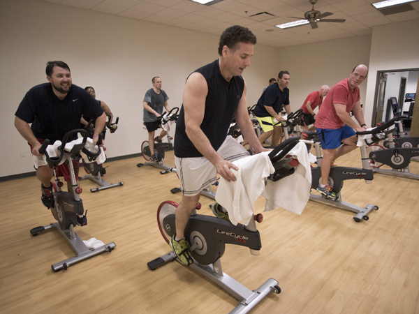 (From left) Matt Nassar, Sessions Roland and Percy Quinn take part in a spin class at the University Wellness Center in downtown Jackson.