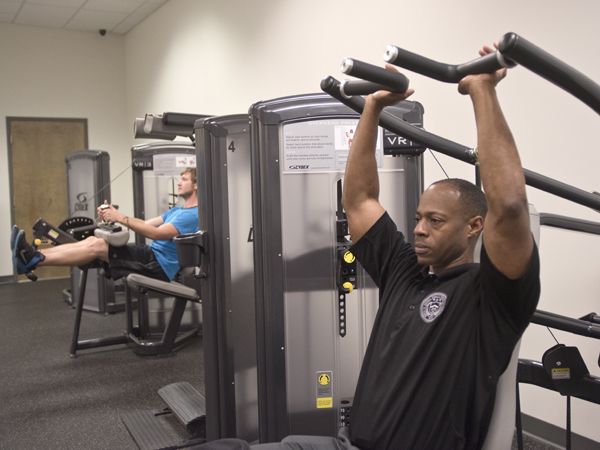 Turner strengthens his upper body muscles during a workout at the University Wellness Center's downtown Jackson facility.