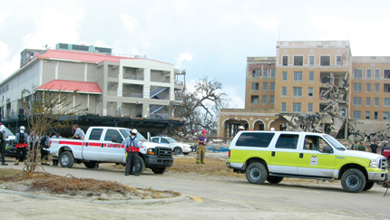 Katrina search and rescue vehicles park outside a damaged casino on the Mississippi Gulf Coast.