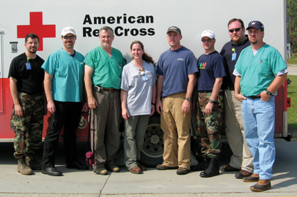 A survey team of Mississippi State Department of Health and UMMC personnel, including Wilson, second from right, pause during its trip to the Mississippi Gulf Coast.