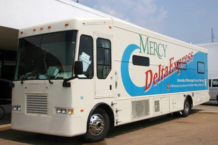 The School of Nursing's Mercy Delta Express delivers medical and dental care to hurricane evacuees at the Mississippi Trademart