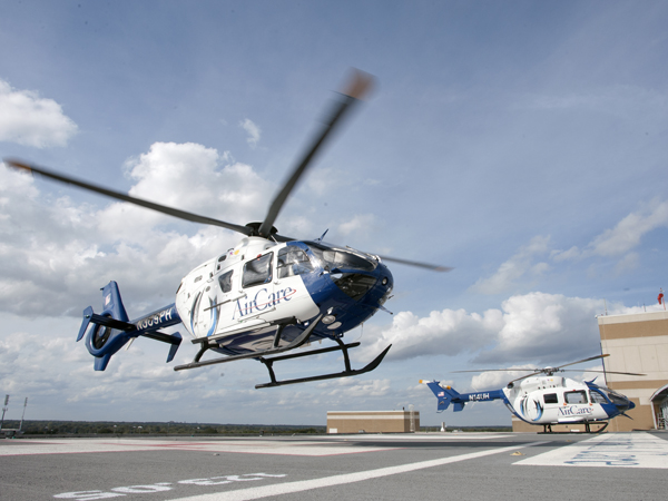 AirCare1 and 2 on the helipad located atop the Conerly Critical Care Hospital.