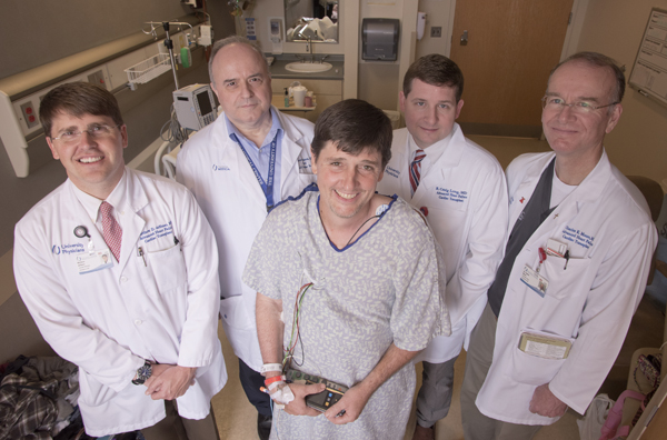 The UMMC heart transplant team of Brad Fitzgerald includes (from left) Dr. Matt deShazo, Dr. Anthony Panos, Dr. Craig Long and Dr. Charles Moore.