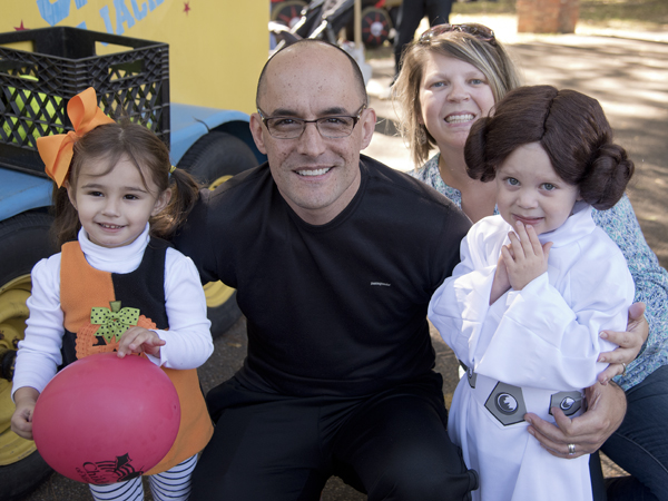 Sybil Cumberland, right, and mom Tara Cumberland of Brandon have some Halloween fun at the home of Children's Heart Center medical director Dr. Jorge Salazar during the center's family reunion in October. At left is Salazar's daughter, Lana.