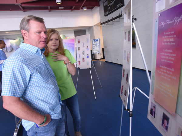 Jackson couple David and Sheila Wilbanks look at posters bearing the photos of organ donors, including their son Walker Wilbanks.