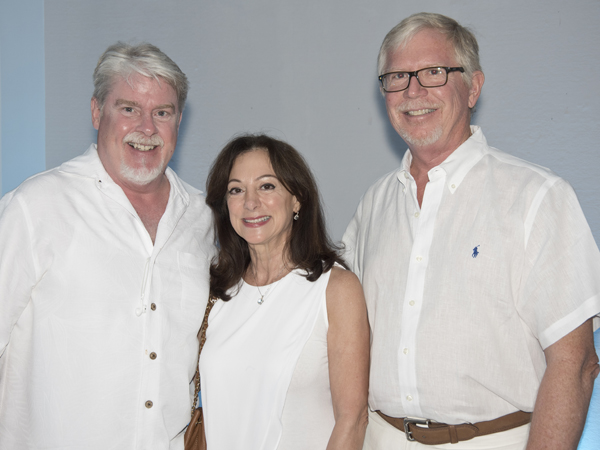 David Spurk, left, smiles with Dr. Susan Buttross, UMMC professor of pediatrics and medical director of the Center for the Advancement of Youth, and her husband, Robert Riddell.
