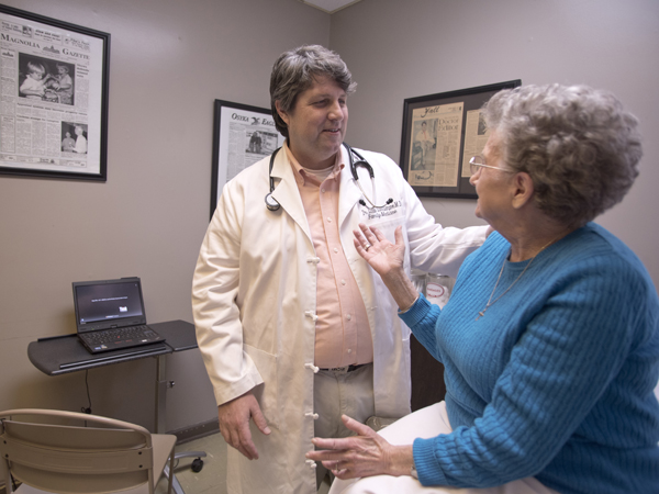 As with many physicians, Lampton says that spending time with patients like Tommie Beck of Magnolia is where he finds joy in the practice of medicine.