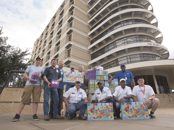 Delivering Walmart's donation of toys for Batson Children's Hospital are, from left, volunteer Joseph Miller and Walmart employees Marty Stroud, Anthony Thompson, Davis Lowery, Darel Wallace, Rickey Oliver, Charlie Collins, Ricky Sharpe, Billy Tingle and Tony Miller.