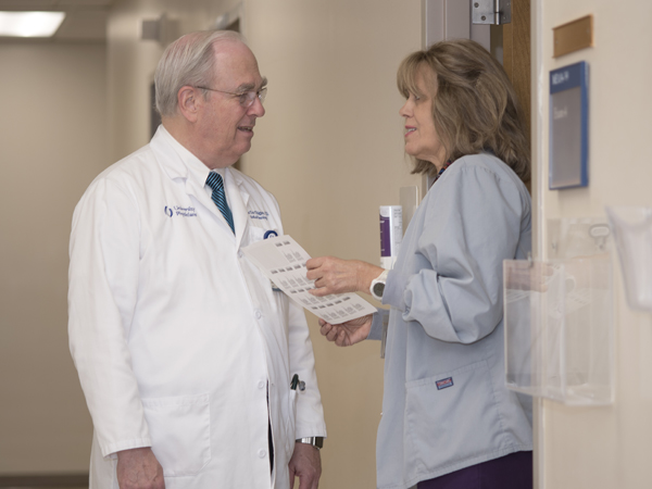 Thigpen discusses a case with Kathy Hyde, nursing supervisor in the Cancer Institute outpatient clinics at Jackson Medical Mall.