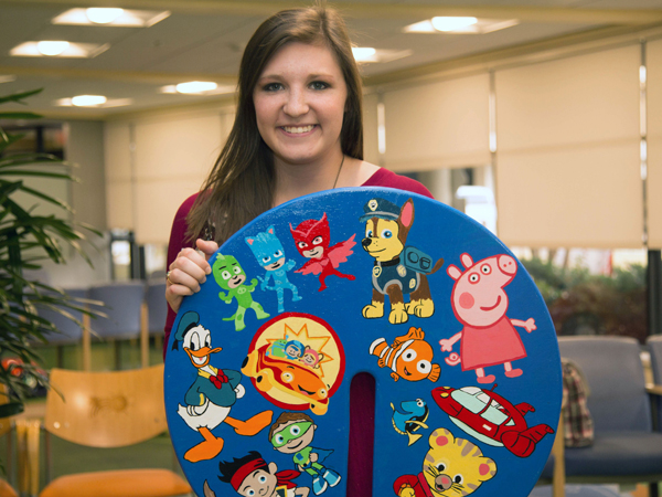 Ashlee Weaver, a third-year nursing student, chose to decorate her board with characters from popular children's television shows.
