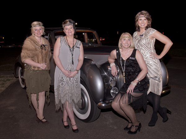 (From left) Heather Griffith, Shana Cook, Vickie Skinner and Kelly Dennis pose in front of a vintage Rolls-Royce.