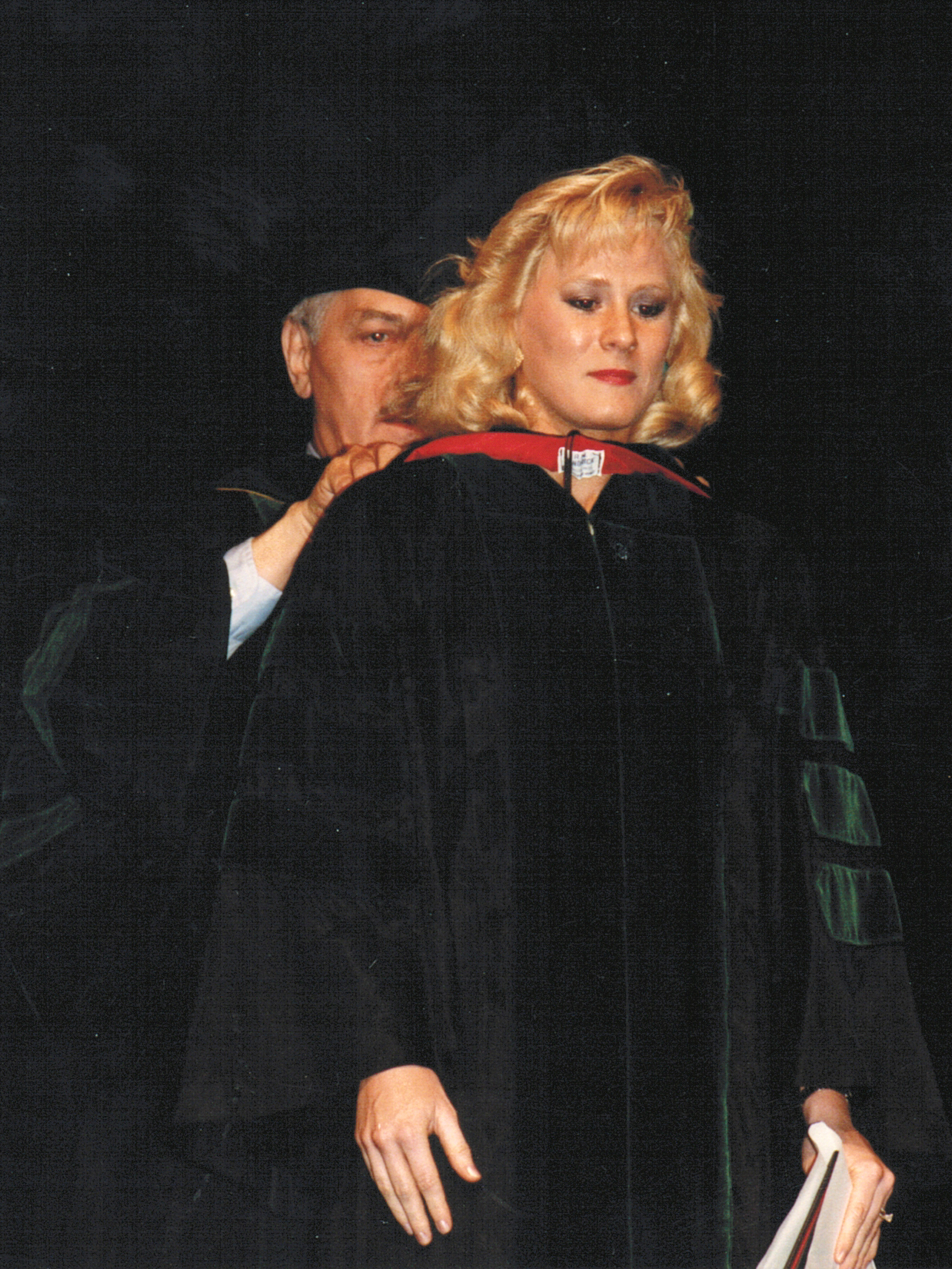 Dr. Toni Bertolet is hooded by Dr. Carl Evers after she received her Doctor of Medicine diploma in 1988.
