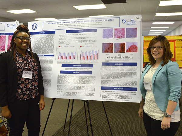 Tameka Jones, left, and Kayla Smith, SHRP Cytotechnology students, won best undergraduate student presentation for their work on bone nodule formation using a pulsed magnetic field.