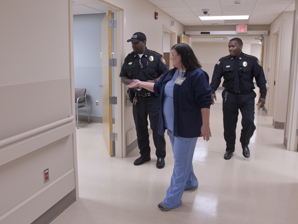 Elizabeth Adcock, manager of performance improvement at UMMC Holmes County, shows off the Lexington hospital's new Emergency Department to Lexington Police Department investigator John Newton (left) and Chief Robert Kirkland Sr.