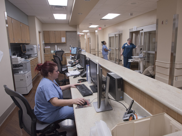 Meredith Worley, a registered nurse at the Women's Urgent Care Center, takes advantage of the center's newly designed work areas.