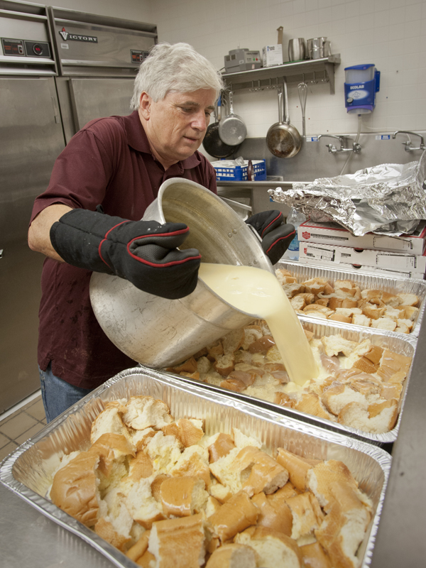 Granger adds the sweet ingredients to make the bread pudding for his school's annual Holiday Open House.