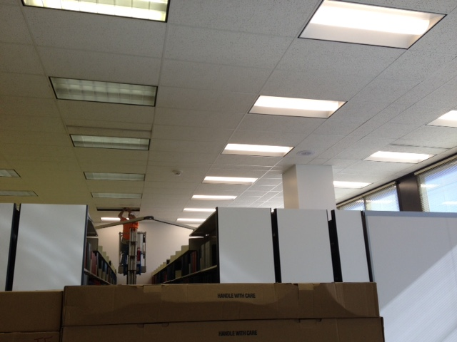 LED lighting outshines is counterpart - fluorescent T-12 lighting - in the stack area of the Rowland Medical Library.